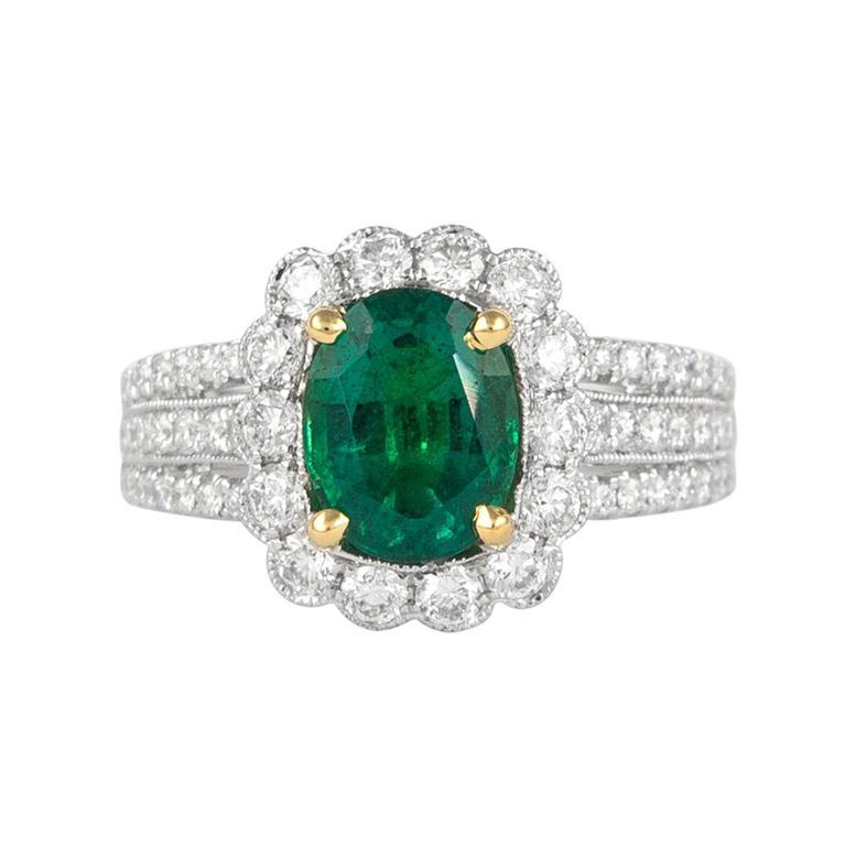 Alexander 1.72 Carat Emerald with Diamond Halo Ring 18 Karat White Gold