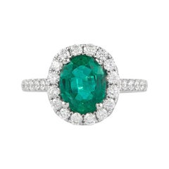 Alexander 1.97 Carat Emerald with Diamond Halo Ring 18 Karat White Gold