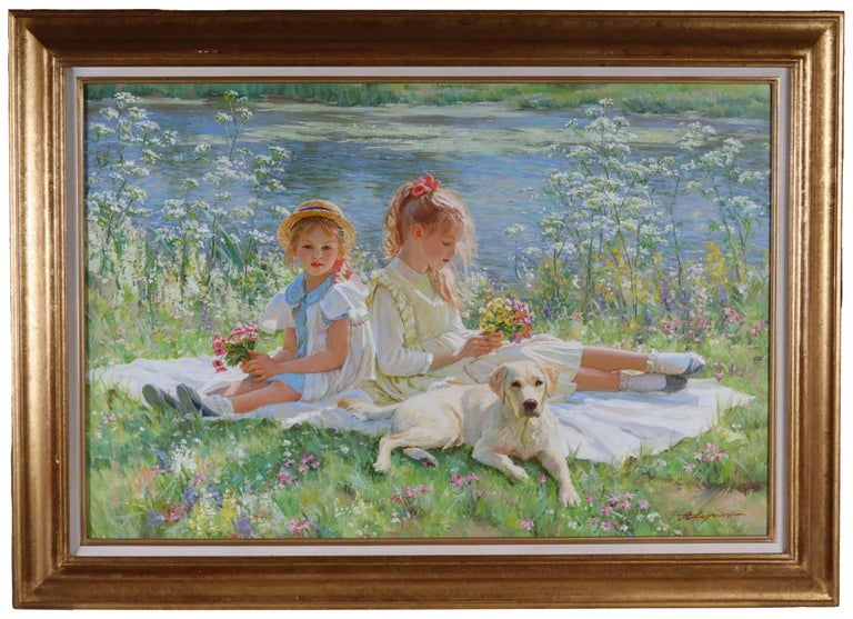 Two Young Girls Sitting on a Blanket on a River Bank with a Labrador Puppy - Painting by Alexander Averin
