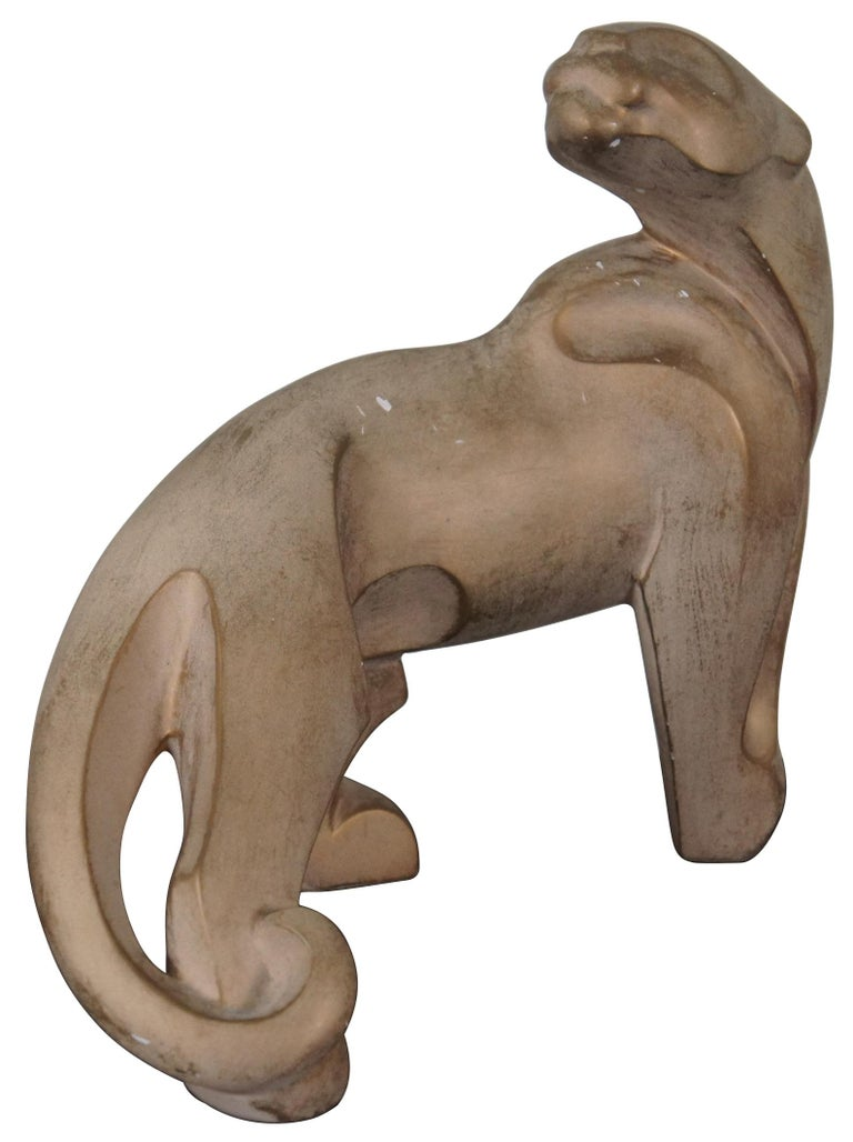 Vintage 1996 brutalist style statue of a mountain lion or jaguar by Alexander Danel, produced by Austin Sculpture.