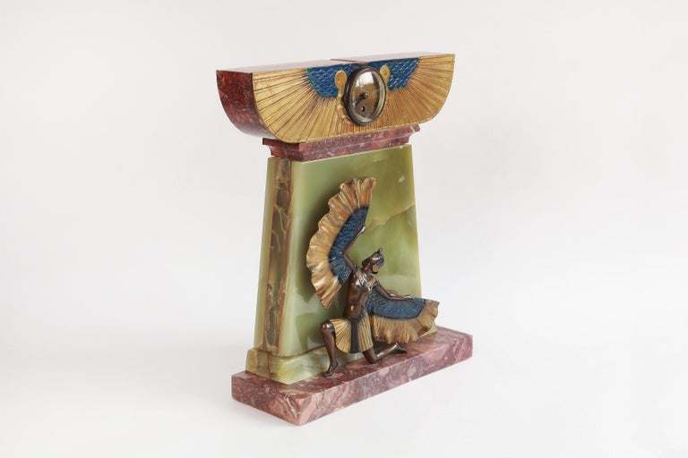 Art Deco mantel clock in Egyptian style, France, circa 1925. Bronze cold-painted, onyx, marble base. Signed top right on the base: KELETY. Measurements: Height 20.47 in (52 cm), width 16.54 in (42 cm), depth 5.91 in (15 cm)  Alexander Kéléty,