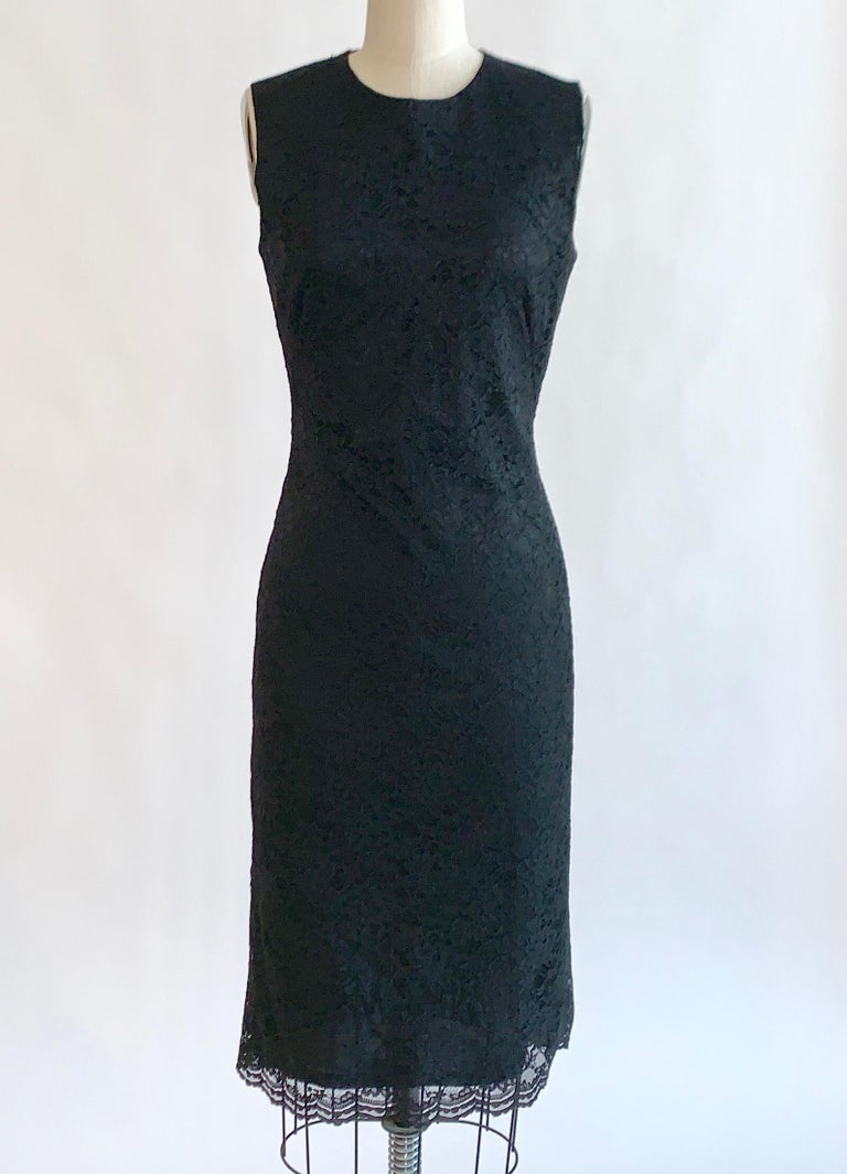 Alexander McQueen black lace sleeveless dress from the designer's Spring 1999 collection. Black calais lace atop a solid black lining. Sleeveless, center back zip.   70% rayon, 30% nylon.  Made in Italy.  Size IT 42, usually US 6, but seems to best