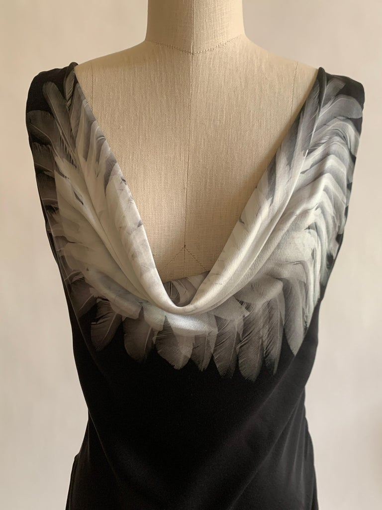 Alexander McQueen black silk bias cut dress with cowl neck featuring grey feather print. Side zip with hook and loop closure.  100% silk. Fully lined in 74% acetate, 26% silk.  Made in Italy.   Size IT 38, approximate US 2. See measurements. Bust