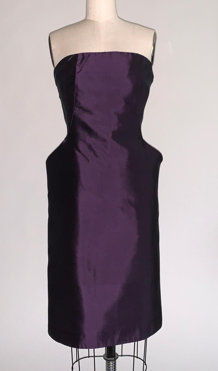 Alexander McQueen purple silk strapless dress with amazing sculptural pockets that flare at hip, giving a dramatic silhouette. Built in bustier/corseting create an even more stunning shape. Back zip and hook and eye. From the Fall 2007 collection,