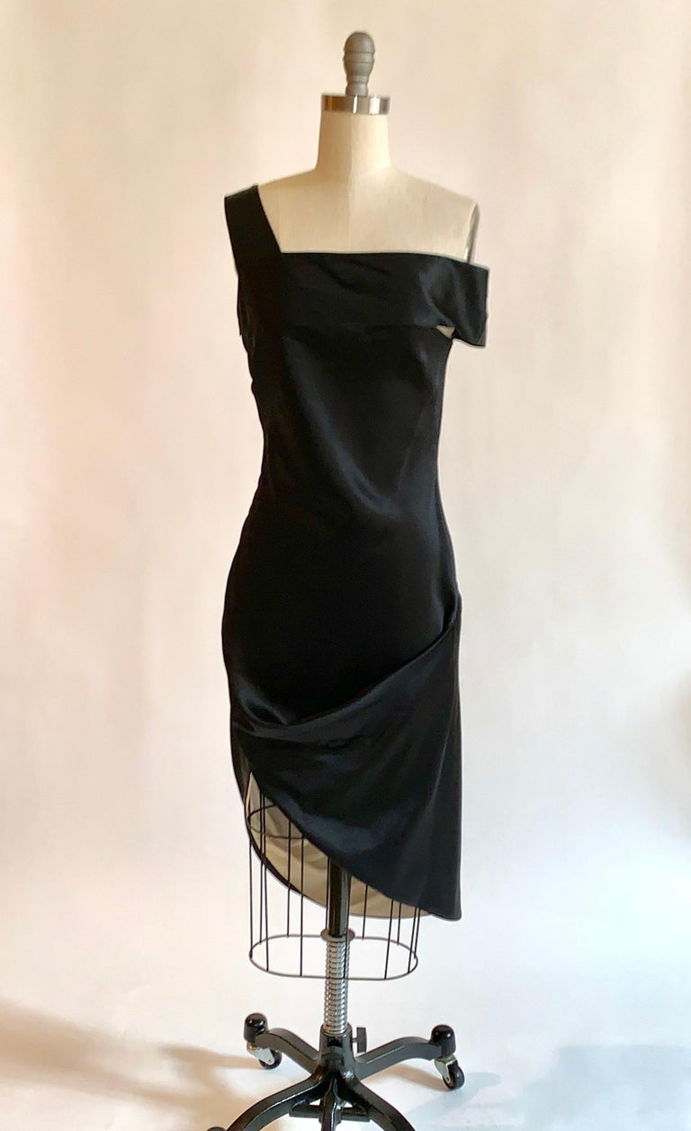 Alexander McQueen black and nude silk dress with asymmetrical neckline (one strap falls just off the shoulder) and drape at skirt from his 2008 collection. Back of skirt is just longer than the front, so that it shows a flash of nude lining when