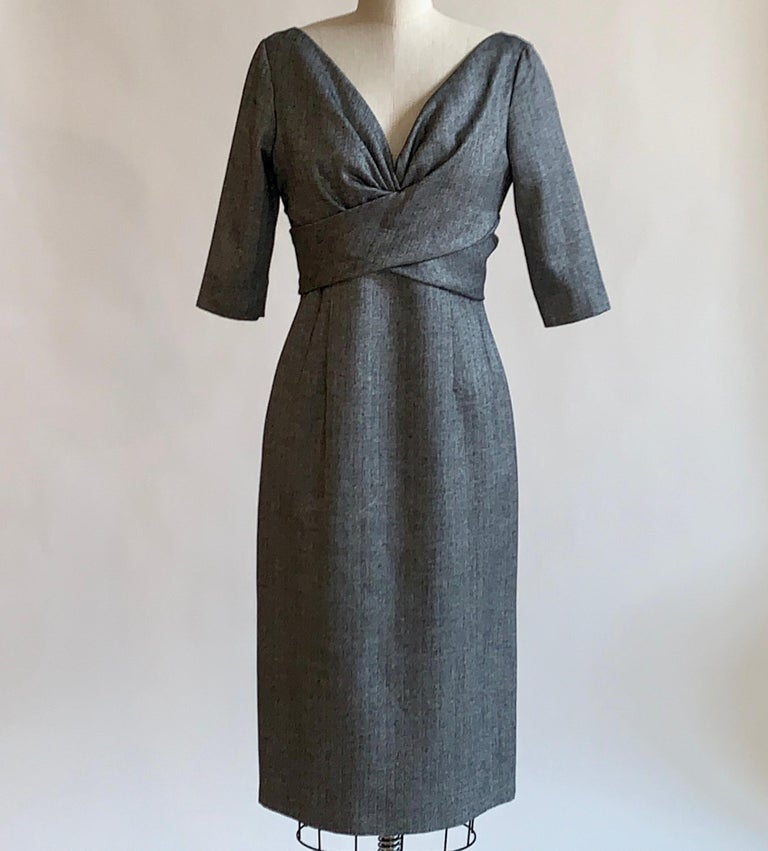 Alexander McQueen 2008 grey and black herringbone pencil dress with mid length sleeve, v neck, and  wrap-style detail at bust. Back zip and hook and loop closure.  50% virgin fleece wool, 45% bamboo, 5% cashmere. Top lined in 50% virgin fleece wool,