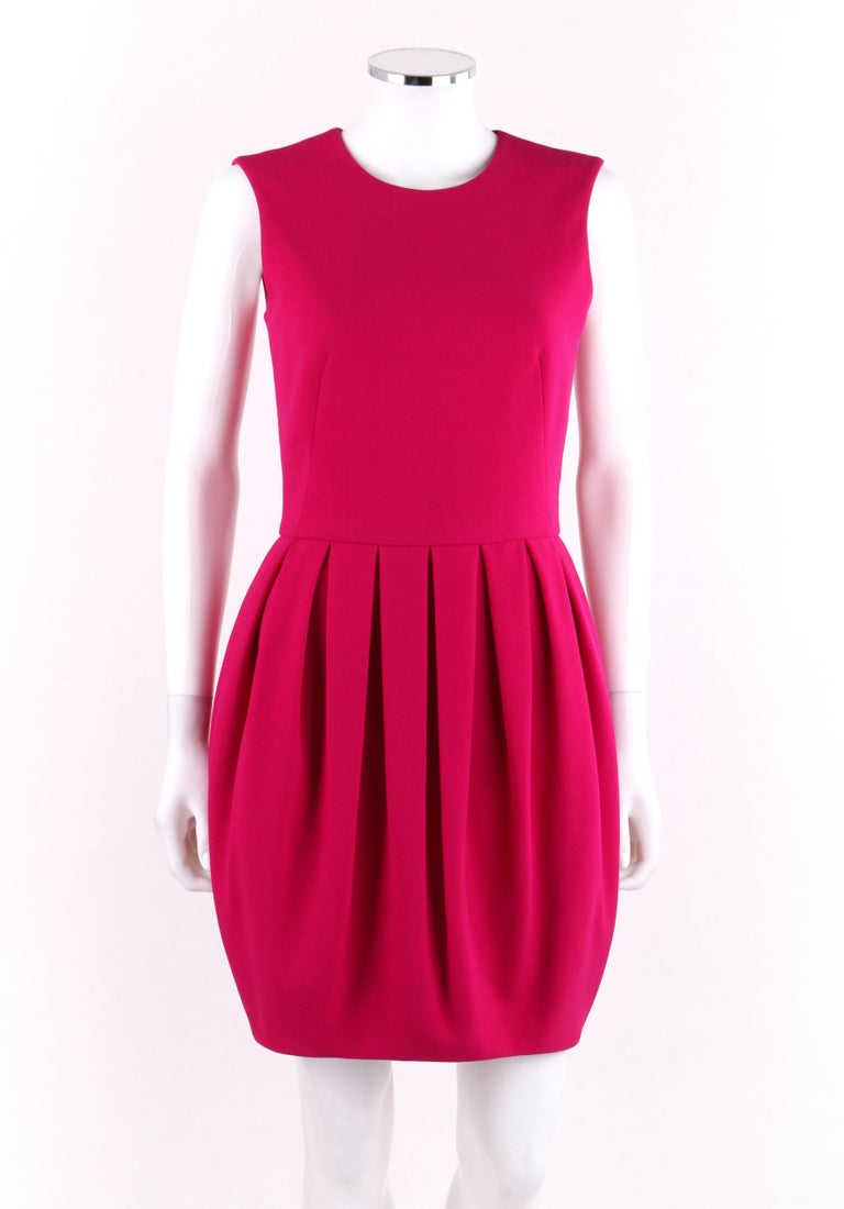 ALEXANDER McQUEEN A/W 2012 Fuchsia Pink Wool Bubble Pegged Tank Mini Dress Size 40     Estimated Retail: $2,240   Brand / Manufacturer: Alexander McQueen  Collection: Autumn / Winter 2012  Style: Fitted dress Color(s): Fuchsia pink Lined: Yes