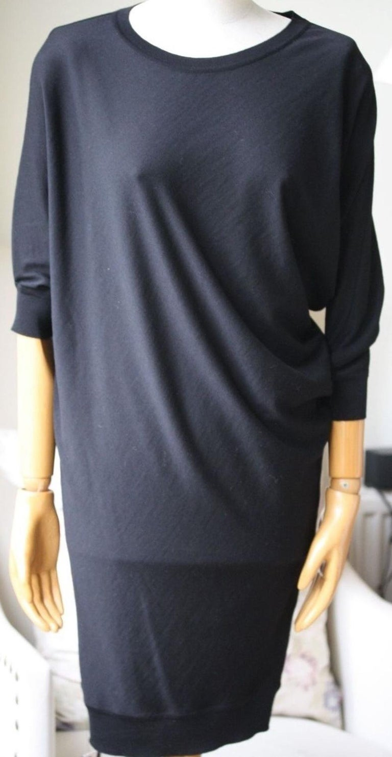 Alexander McQueen's asymmetric sweater dress has been crafted in Italy from soft mid-weight wool. This dolman-sleeve style will work day or night. Black mid-weight wool. Asymmetric dolman sleeves, ribbed trims. Slips on. 100% wool. Designer colour: