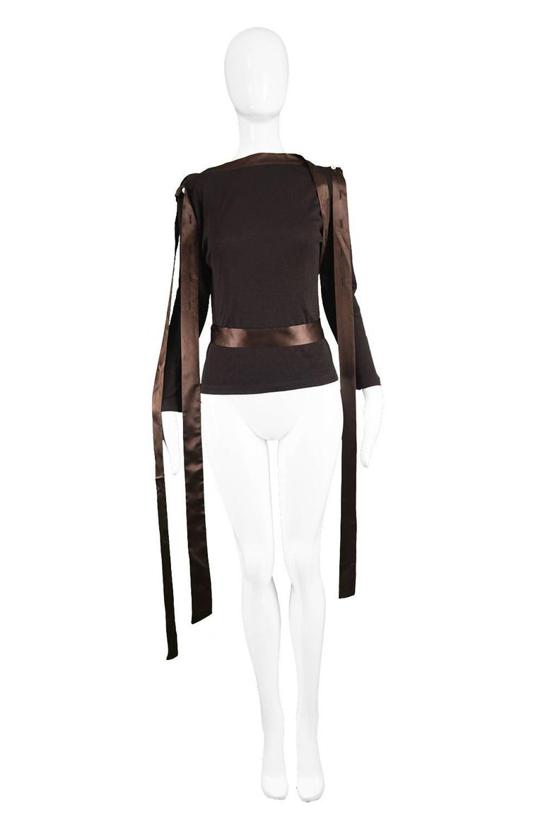 "Alexander Mcqueen A/W 2000 'Eshu' Satin Ribbon & Cotton Jersey Bondage Top  Size: Marked 42 which roughly a UK 14/ US 10. Please check measurements.  Bust - 38"" / 96cm Waist - 32"" / 81cm Length (Shoulder to Hem) - 21"" / 53cm Shoulder to Shoulder -"