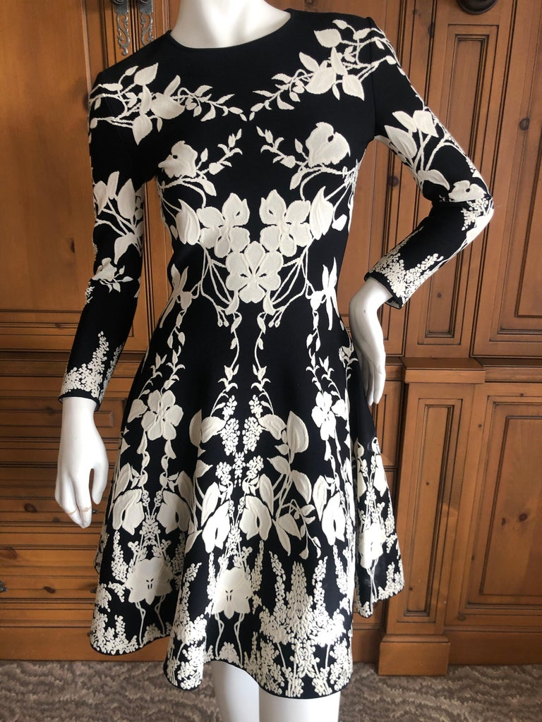 Alexander McQueen Black and White Inartsia Floral Knit Dress with Skater Skirt. 2017 So pretty, please use the zoom feature to see the details Size XS , there is a lot of stretch   Bust 34