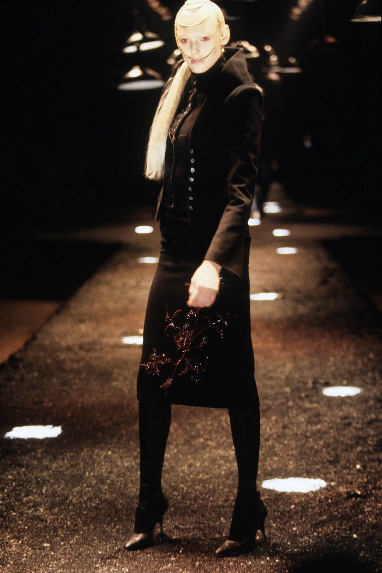 Alexander McQueen black cashmere pencil skirt beaded with flowers of blood-red bugle beads to front and lined in monogrammed red silk.  Fall-Winter 1998