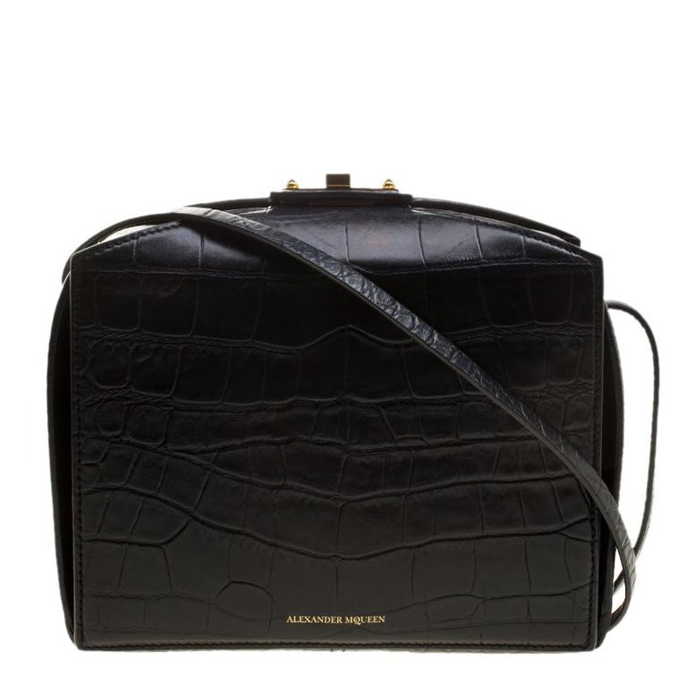 From the house of Alexander McQueen comes this gorgeous box bag that will perfectly complement all your outfits. It has been luxuriously crafted from croc-embossed leather and styled into a box shape with a turn lock on top and a spacious suede