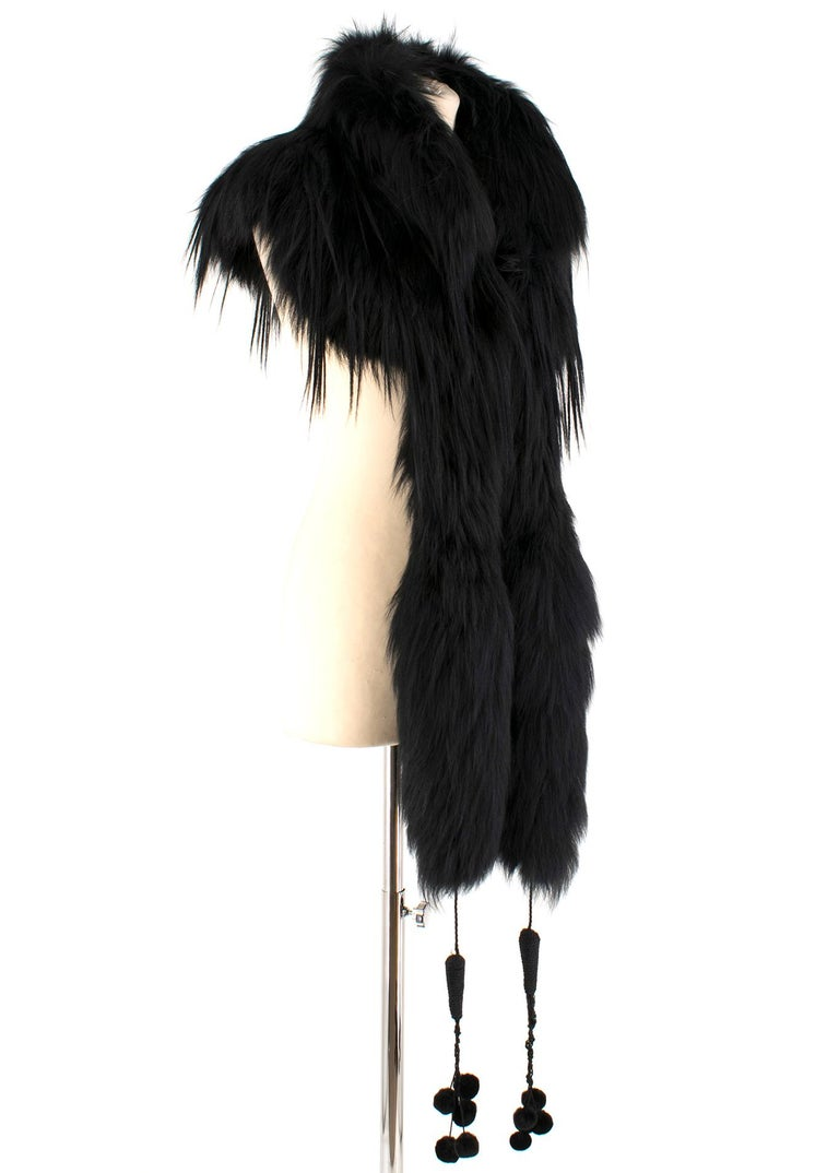 Alexander McQueen Black Fur Cape Scarf  - Oversize collar - Long front tassels with pom poms - Hooks to fasten at neckline - Fur origin: Finland - Material: 100% Seta - Lining: 100% silk - Made in Italy.  Please note, these items are pre-owned and