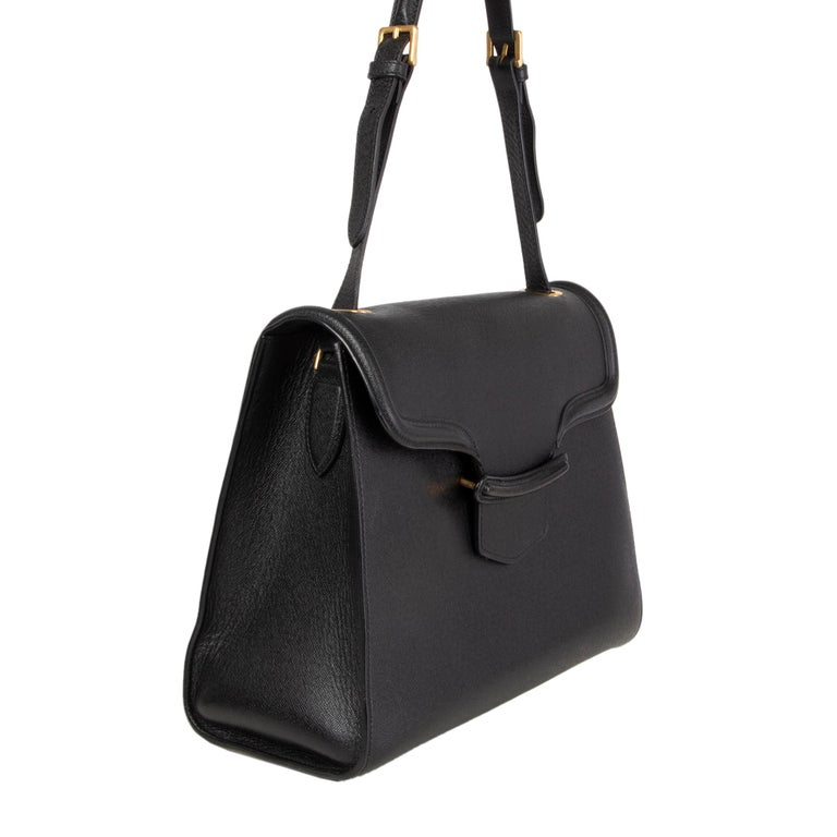 Alexander McQueen 'Heroine' shoulder bag in black textured leather. Lined in black suede with two open pockets against the front and a zipper pocket against the back. Has been carried and is in excellent condition.  Height 26cm (10.1in) Width 34cm
