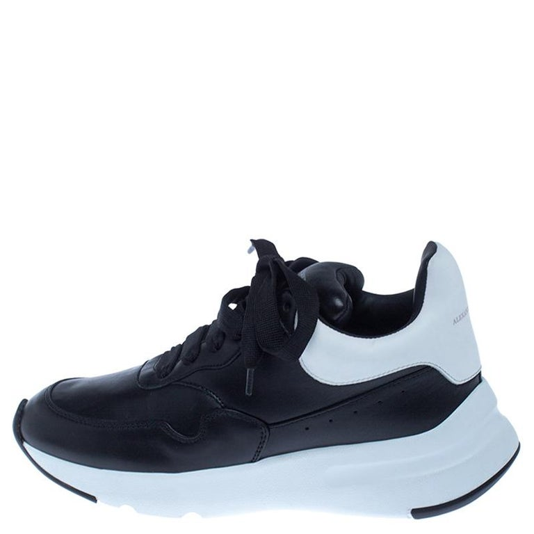 These sneakers from Alexander McQueen are so chic, you'll love wearing them for your fun outings with friends! The black sneakers are crafted from leather and feature round toes. They flaunt lace-ups on the vamps and contrasting panels on the