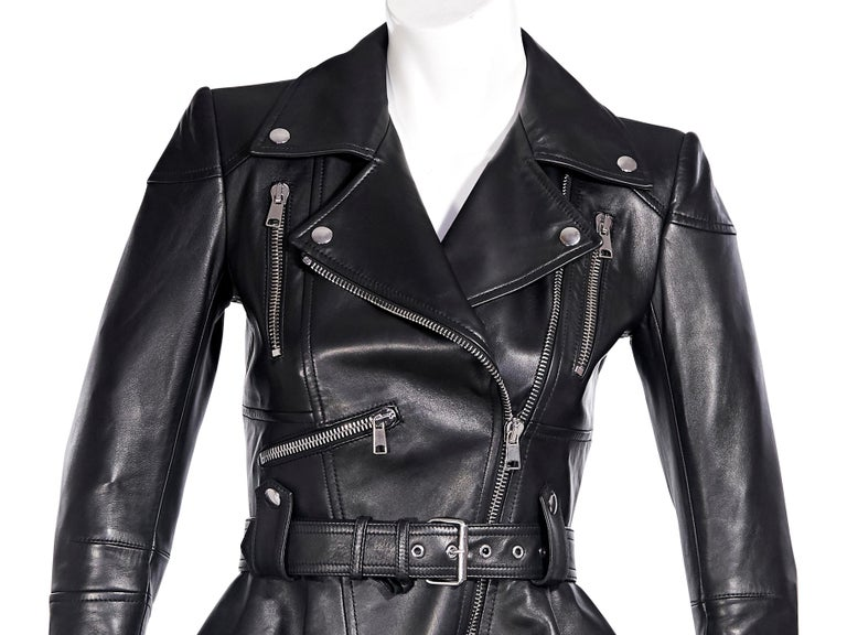 Product details:  Black leather peplum jacket by Alexander McQueen.  Notched lapel.  Long sleeves.  Asymmetrical zip-front closure.  Adjustable belted waist.  Chest and waist zip pockets.  Silvertone hardware.  32