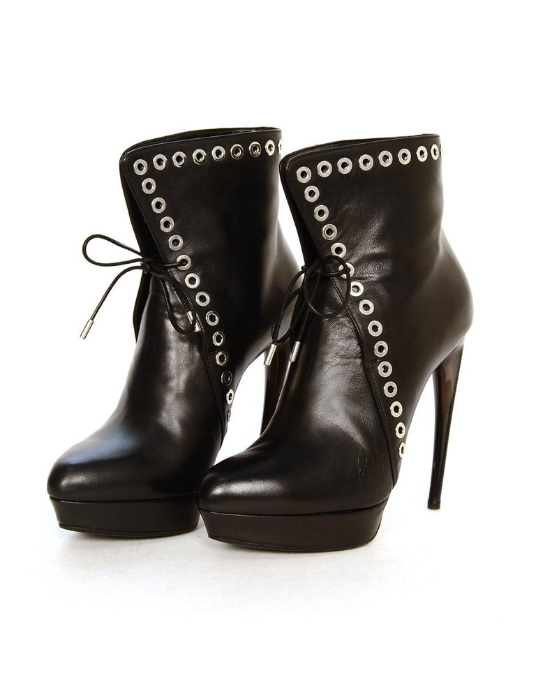 Alexander McQueen Black Leather Silvertone Grommet Heeled Platform Boots Sz 37 In Excellent Condition For Sale In New York, NY