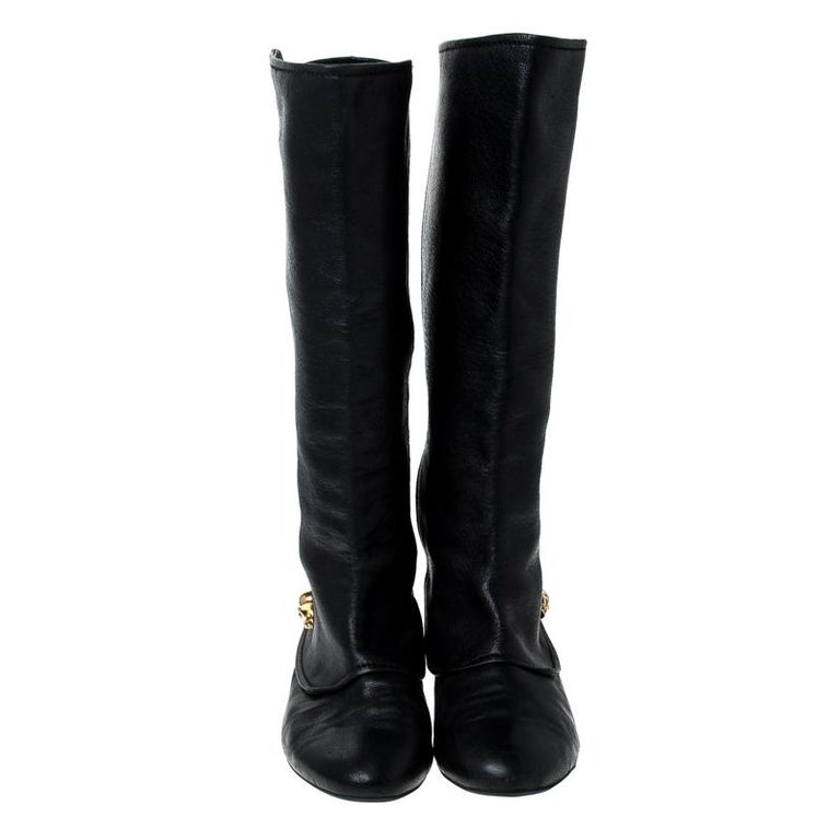 Creations as fashionable as this pair of knee-length boots from Alexander McQueen deserves to be in every woman's closet. They've been created from black leather and designed with round toes, signature skull charms and tough soles.  Includes: