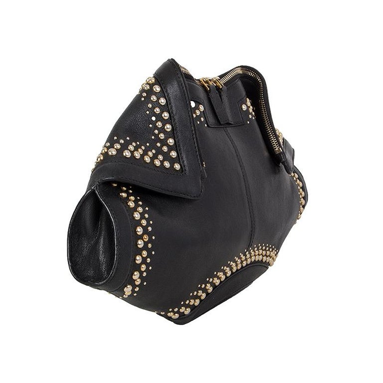 Alexander McQueen 'De Manta Studded' clutch in black leather with gold-to-silver-tone studs. Closes with a two-way zipper on top. Lined in black cotton with an open pocket against the back. Has been carried and is in excellent condition.   Height