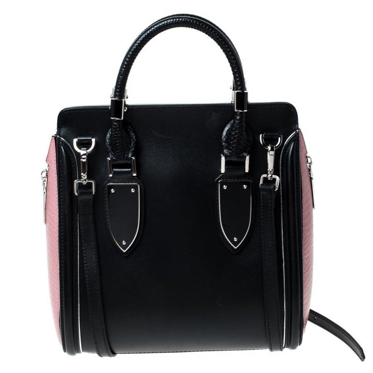 Every woman needs a bag that is pretty and functional, just like this shoulder bag from Alexander McQueen. Crafted from leather, it has been styled with a flap leading to a spacious suede interior and it is held by two top handles. This is