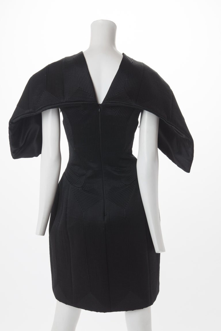 Women's Alexander McQueen Black Quilted Satin Cocktail Dress with Batwing Sleeves, 2009. For Sale