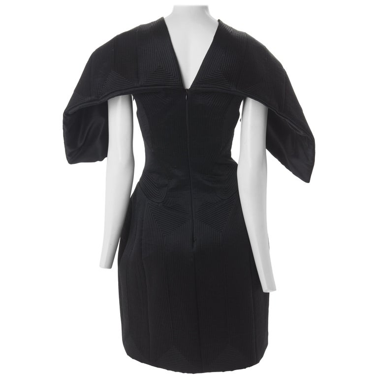 Alexander McQueen Black Quilted Satin Cocktail Dress with Batwing Sleeves, 2009. For Sale