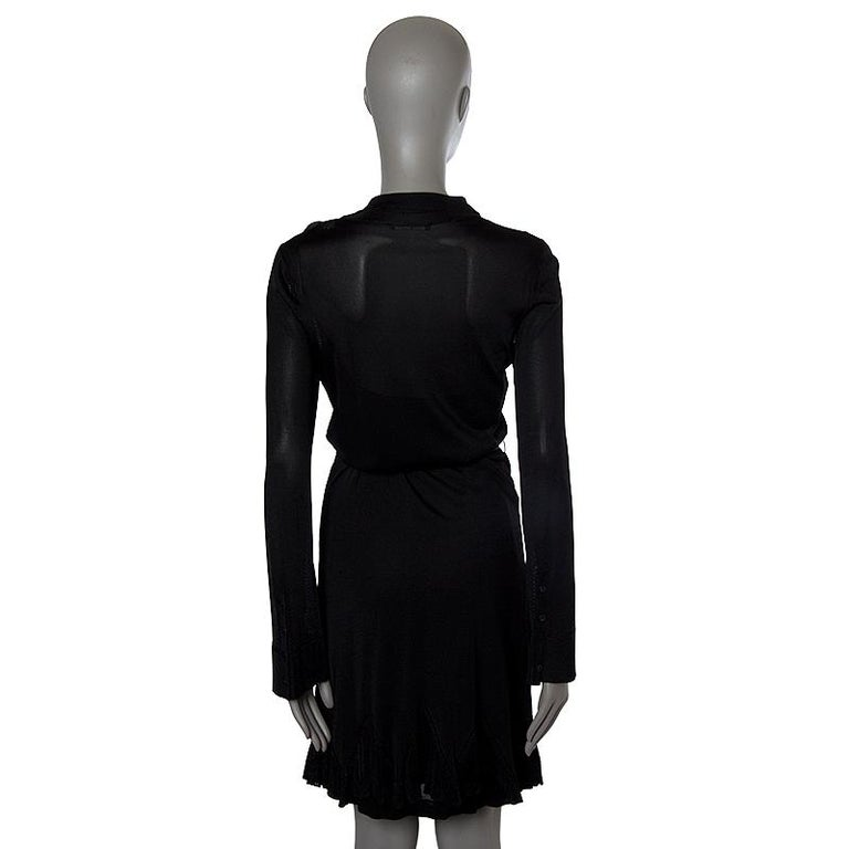 Alexander McQueen sheer knit long-sleeve shirt-dress in black rayon )100%). With flat collar, patch pocket on the chest, buttoned cuffs, godet skirt, belt loops, and belt strap. CLoses with black bottons on the front. Comes with slip in black