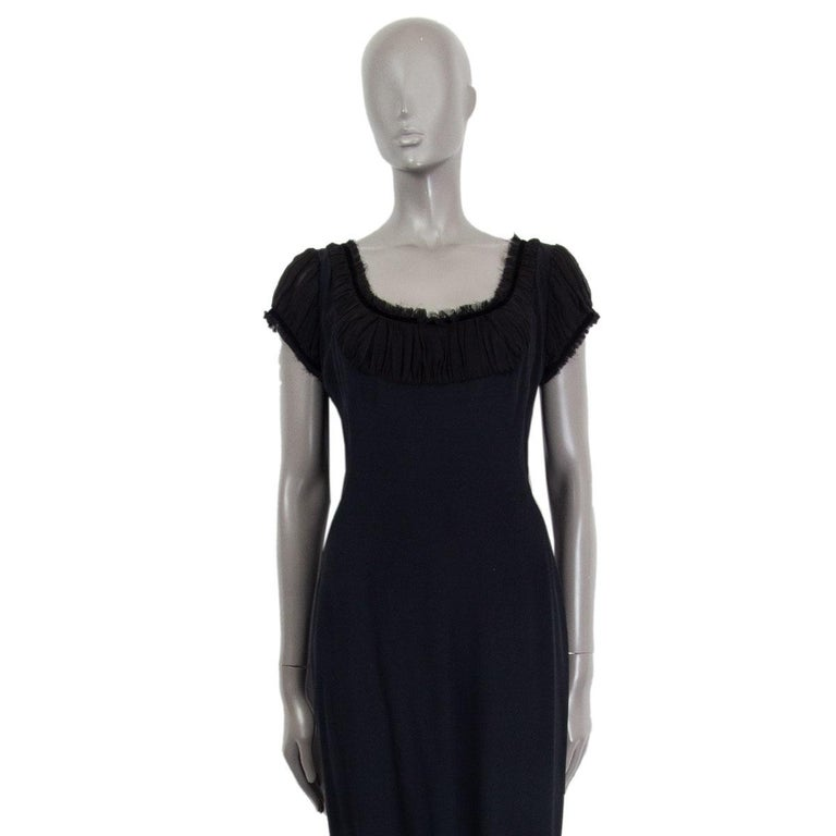 Alexander McQueen gathered short sleeve sheath dress in black acetate (45%), viscose (45%) and silk (10%) with a wide neck. Closes on the back with a concealed zipper. Lined in acetate (74%) and silk (26%). Has been worn and is in excellent