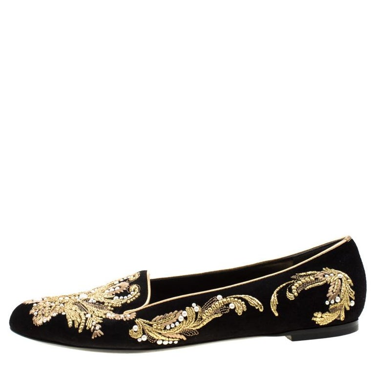 One look at this pair from Alexander McQueen and you'll know what your shoe collection has been missing all along! Crafted with excellence using suede and detailed with luscious gold embroidery, these smoking slippers are simply luxe. Round toes,