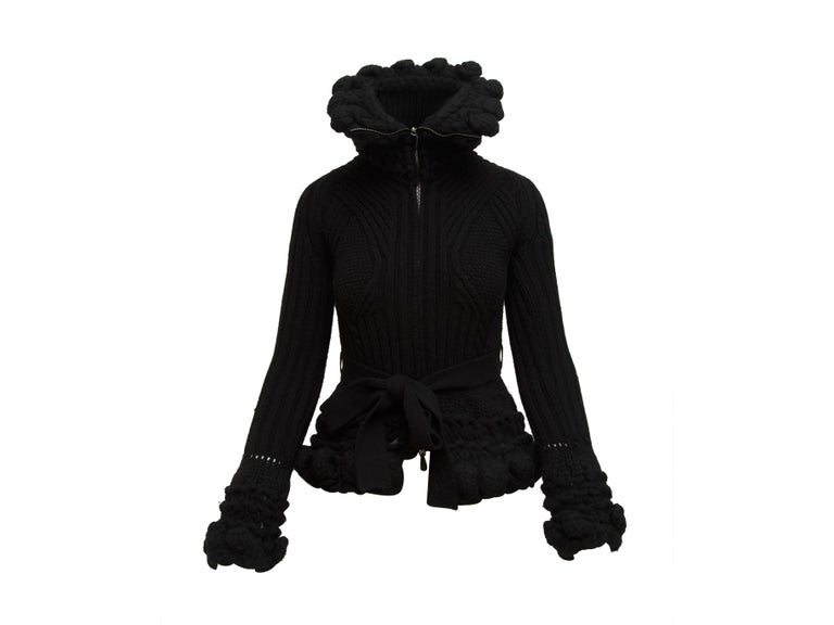 Product details:  Black turtleneck knit jacket by Alexander McQueen.  Long sleeves.  Zip-front closure.  Self-tie waist.  32