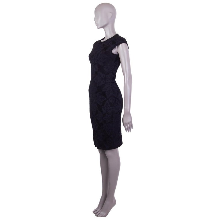 Alexander McQueen bodycon jacquard velvet dress in black viscose (67%), polyamide (26%), polyester (6%) and elastane (1%) with a round neck. Unlined. Has been worn and is in excellent condition.   Tag Size S Size S Shoulder Width 41cm (16in) Bust