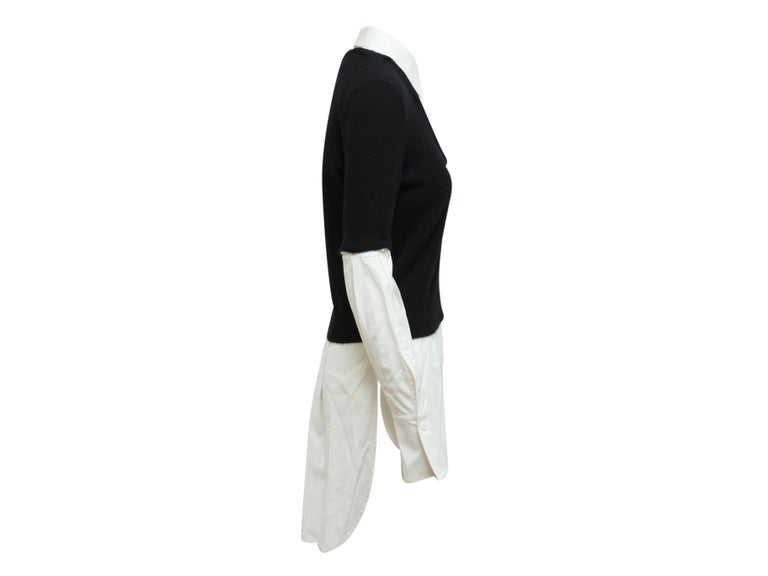Product details: Black and white layered wool and cashmere sweater by Alexander McQueen. V-neck. Long sleeves. Detachable underlay featuring pointed collar. 38