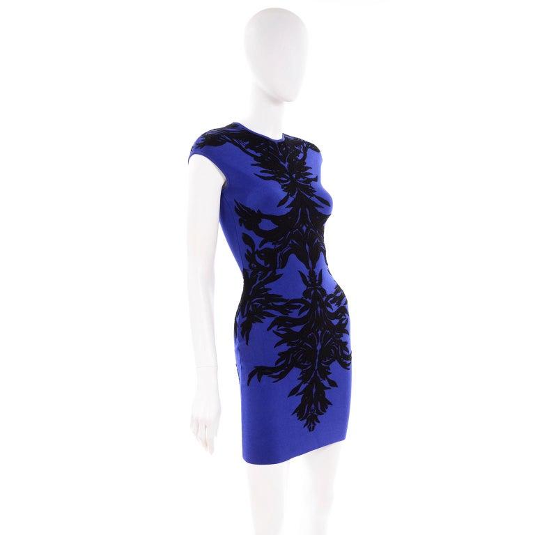 This brilliant blue Alexander McQueen dress has a black