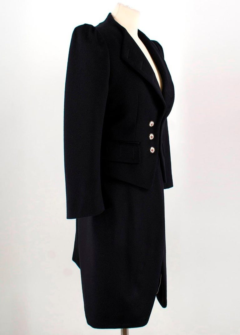 Alexander mcqueen's Black wool Tailored coat.   - structured stand collar and padded shoulders - Made in Italy - Antiqued floral stone metal crest buttons are a refined touch, while the back pleats complement the elongated silhouette. - Fully lined