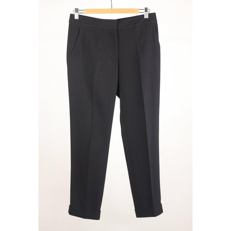 MATERIAL: Acetate COLOR: Black MODEL: Trousers GENDER: Women SIZE: Small COUNTRY OF MANUFACTURE: Italy Condition CONDITION DETAILS: A :EXCELLENT CONDITION - Used once or twice. Looks mint. Imperceptible signs of wear may be present due to storage