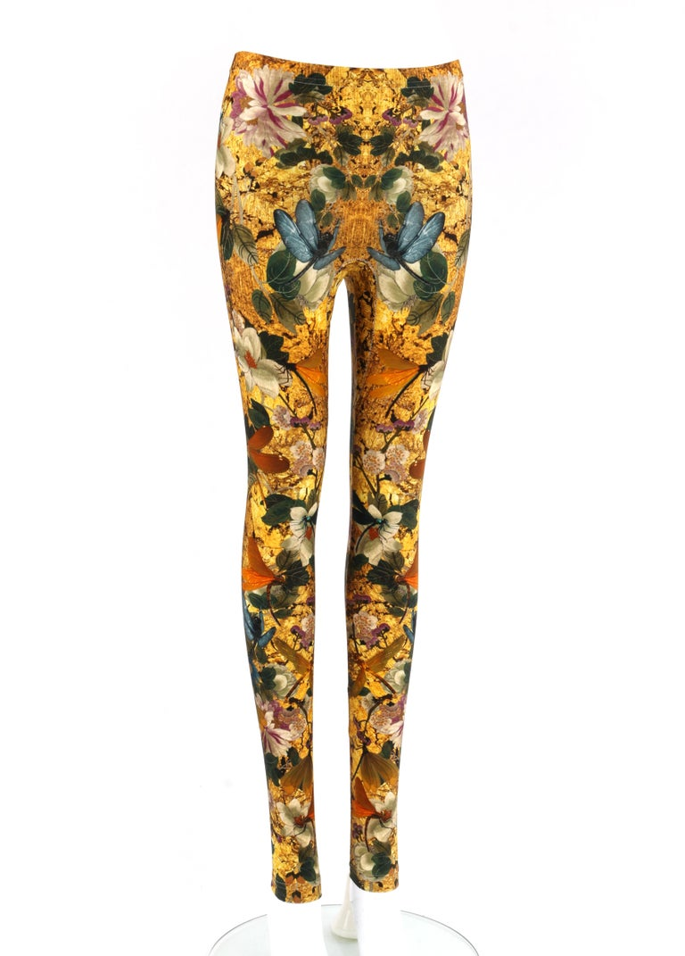 ALEXANDER McQUEEN Multicolor Dragonfly Floral Printed Stretch Legging Pant  Brand / Manufacturer: Alexander McQueen Designer: Alexander McQueen Style: Stretch legging Color(s): Shades of gold, brown, orange, blue, green, violet Lined: No Marked