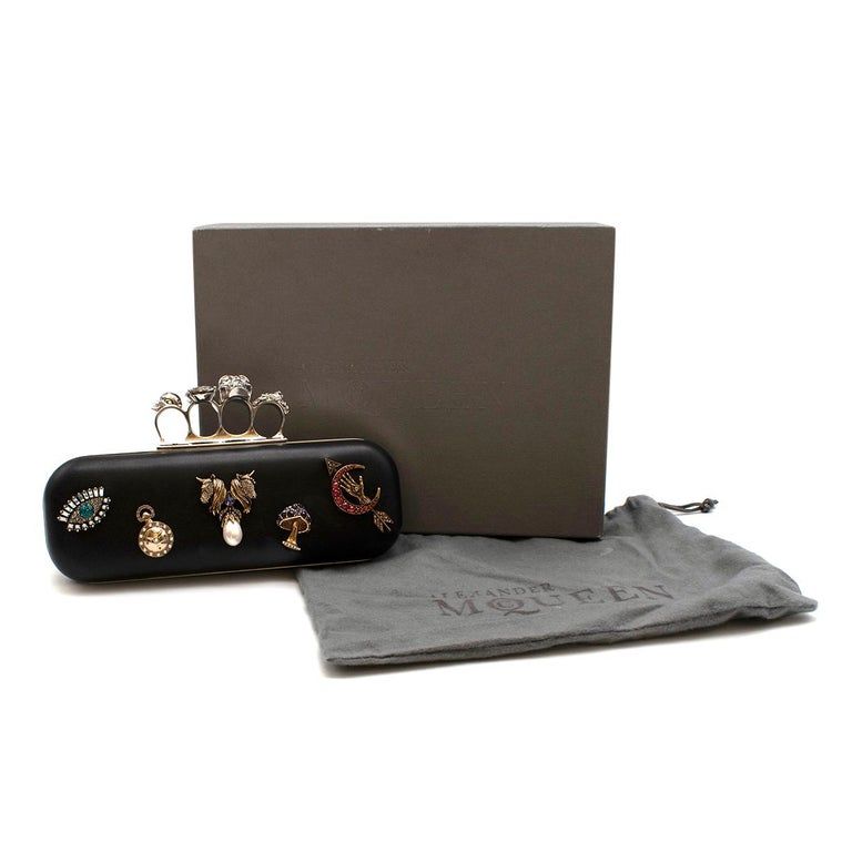 Alexander McQueen embellished black leather four-ring clutch bag  - Silver push-clasp fastening - Soft Black Calfskin Body with calfskin lining - Designed with silver and gold-tone hardware - Embellished with faux pearl and crystal classic McQueen