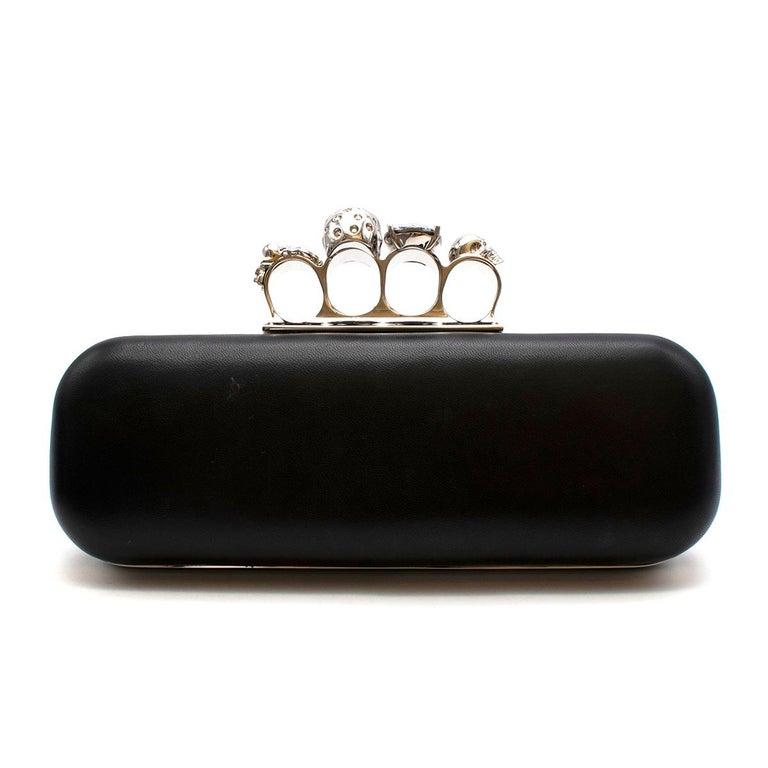 Black Alexander McQueen embellished black leather four-ring clutch bag