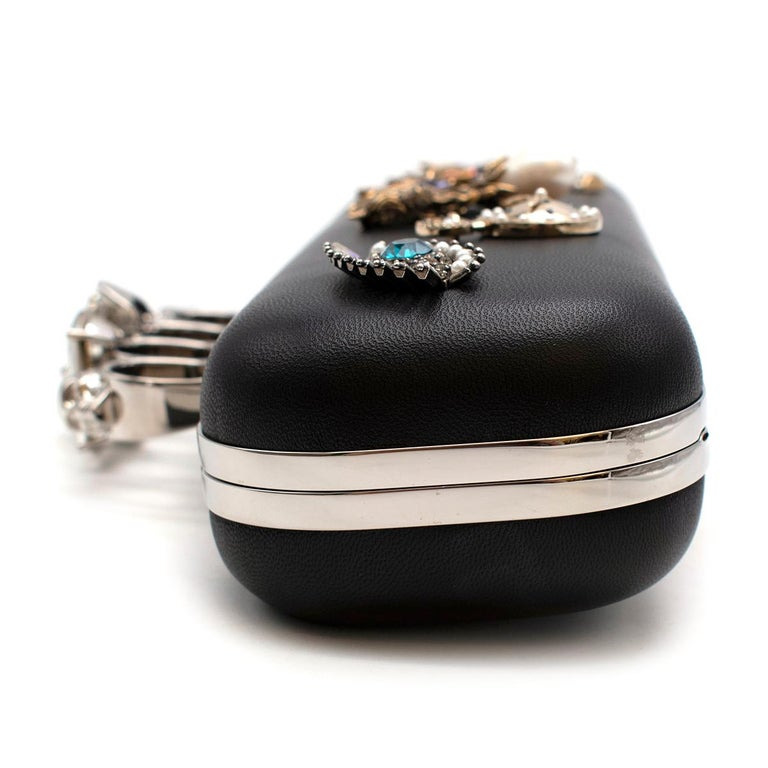 Alexander McQueen embellished black leather four-ring clutch bag  1