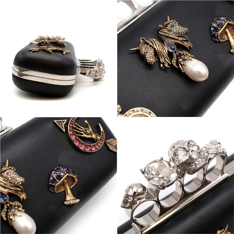 Alexander McQueen embellished black leather four-ring clutch bag  3