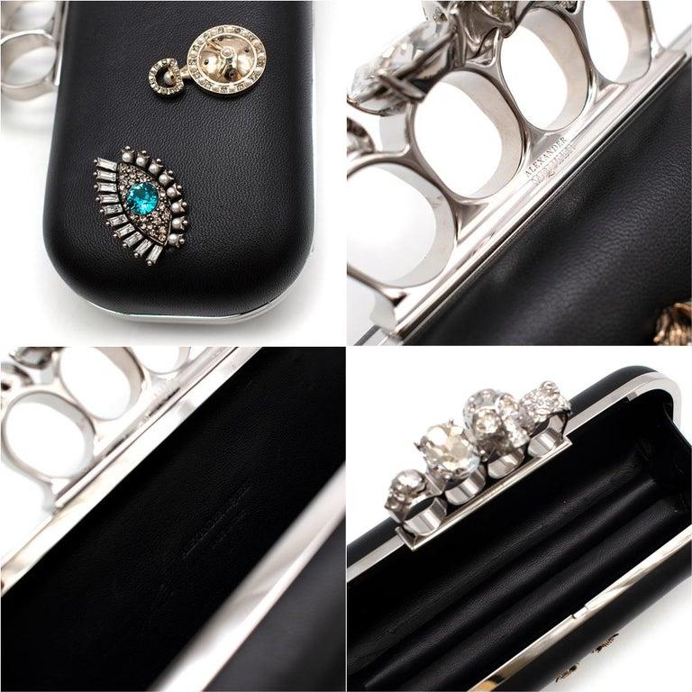 Alexander McQueen embellished black leather four-ring clutch bag  4
