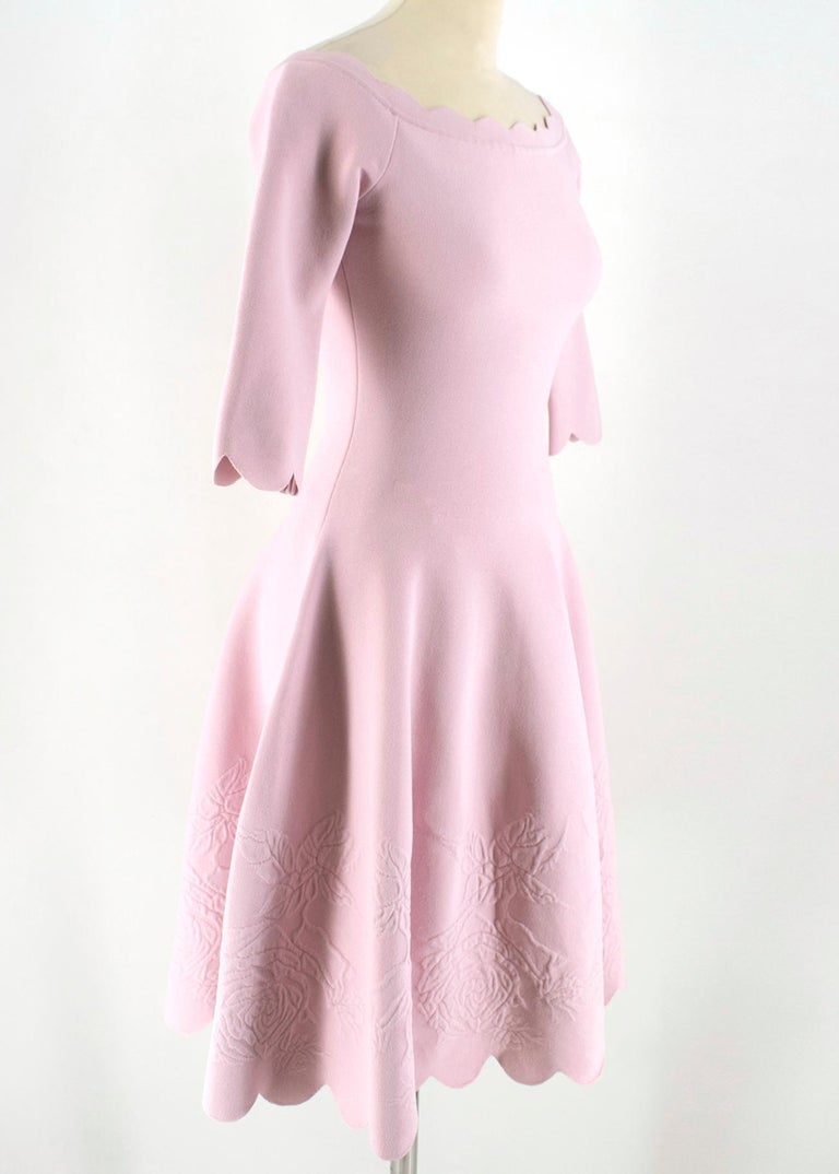 Alexander McQueen Floral Jacquard Knit Pink Scalloped Dress  - Open top - Bateau neckline - Drop shoulders - Short sleeves - Rose pattern details  - Vertical embossed folds - Made in Italy  Please note, these items are pre-owned and may show some