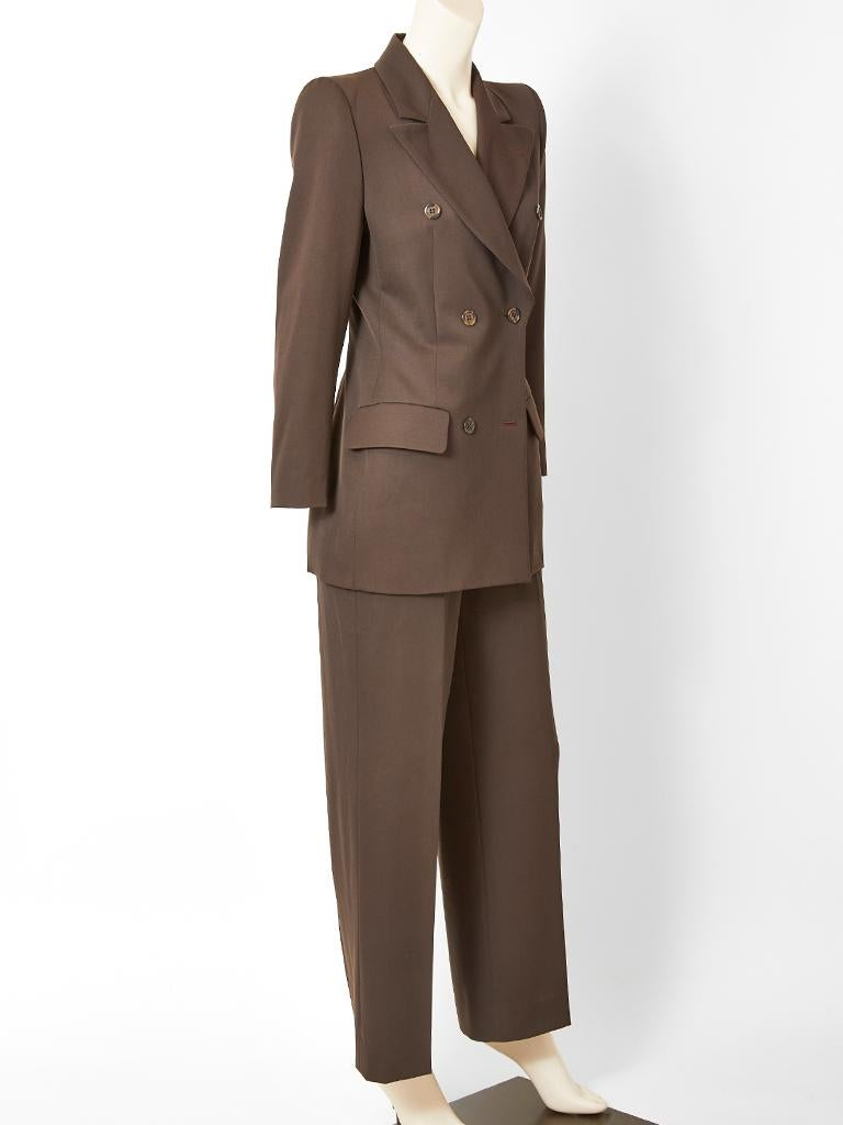Alexander McQueen for Givenchy Couture, chocolate brown, double breasted, wool, trouser suit, having wide lapels, a semi fitted jacket and an exaggerated shoulder silhouette. Jacket has flap pockets at the hip. Trousers have a fly front.