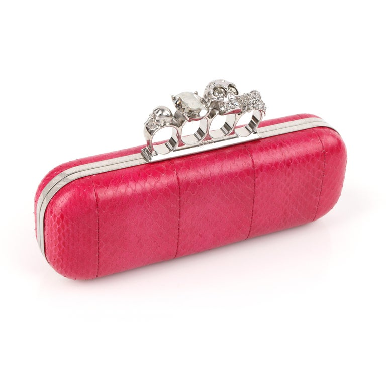 DESCRIPTION: ALEXANDER McQUEEN Fuchsia Pink Python Knuckle-Duster Box Clutch   Estimated Retail: $2,545   Brand / Manufacturer: Alexander McQueen Style: Clutch Color(s): Shades of pink Lined: Yes Unmarked Fabric Content (feel of): Python /
