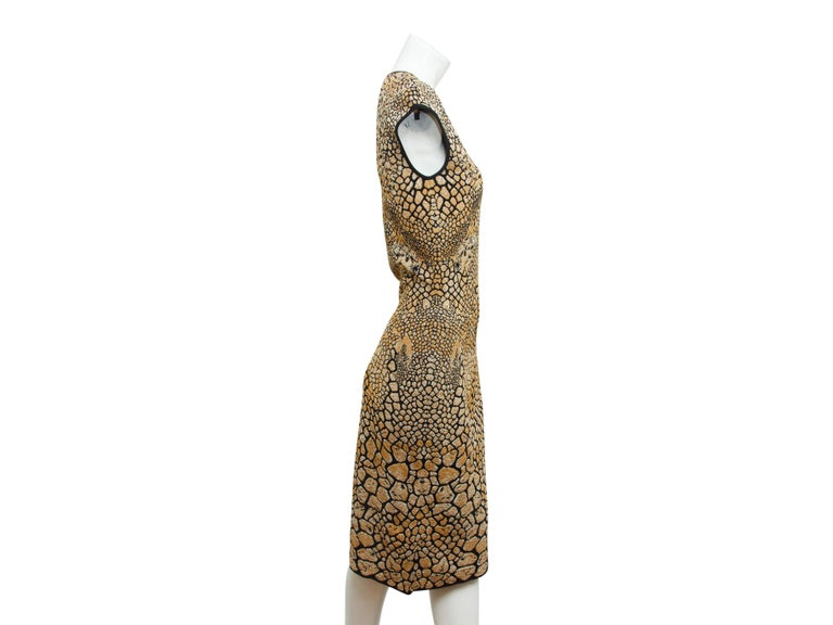 Product details:  Gold and black animal stretch sheath dress by Alexander McQueen.  Crewneck.  Cap sleeves.  Pullover style.  30