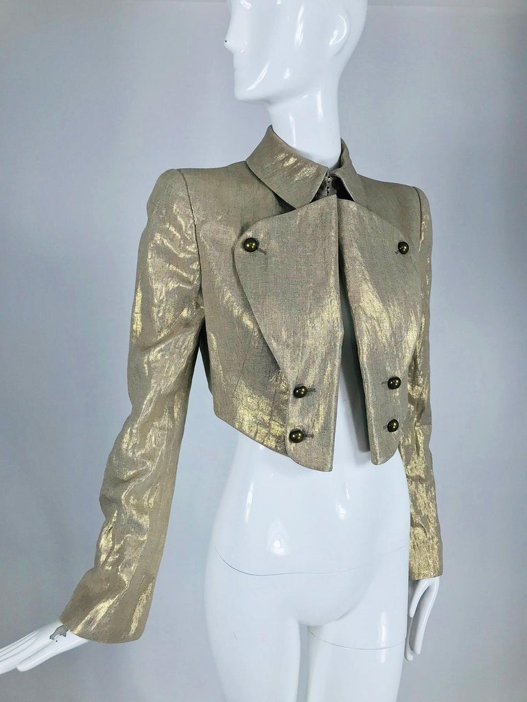 Alexander McQueen gold linen cropped military jacket. Gorgeous gold linen jacket in a cropped military style with high stand up collar, the front lapels turn back and are oversized with half round brass buttons at the top and high waist. The jacket