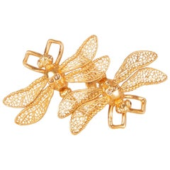 ALEXANDER MCQUEEN gold-tone brass TWIN SKUL DRAGONFLY Ring 6.5