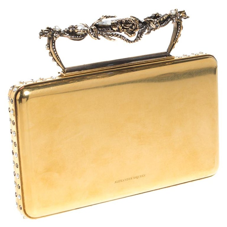 Creations so breathtaking and creative are hard to find! This awe-inspiring clutch from Alexander McQueen is just what you need to grab all the attention at those soirees and parties. We love the astoundingly designed top handle that makes this