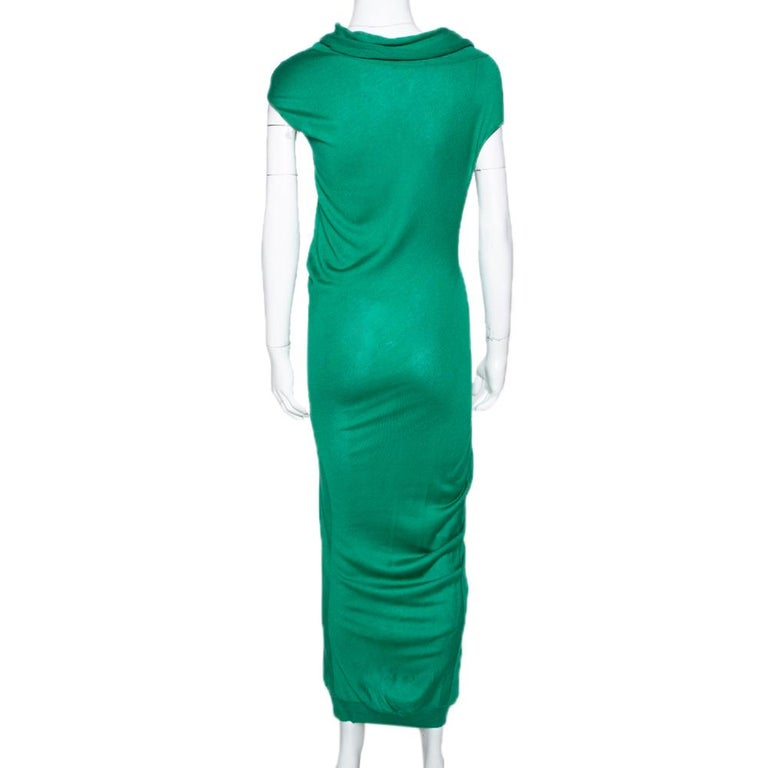 This creation from Alexander McQueen is so perfect it will not only give you a fabulous fit but will also lift your spirits because wearing good clothes can give one a pleasant feeling. Designed with a draped neckline, this fitted dress can be worn