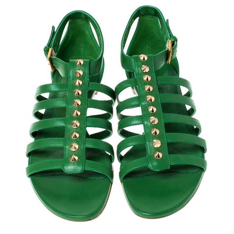 These gladiator sandals from Alexander McQueen are perfect to adorn your feet and make you stand out like no other! The green sandals are crafted from leather and feature an open toe silhouette. They've been styled with multiple gold-tone spikes